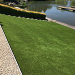 25mm Artificial grass lawn on slope leading to the water's edge