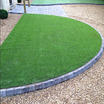 Artificial grass driveway 14mm single size gravel - close up