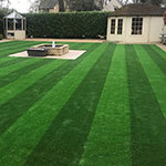Striped artificial grass lawn