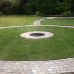 Bradstone graphite paving surrounding grass area and water feature