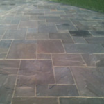 Bradstone autumn green Indian stone paving with buff pointing