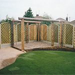 Loggia, chevron arch fencing and turf