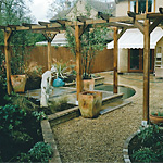 Pergola, pond and raised borders