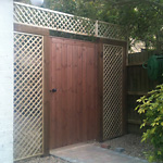 Tongue and grove gate surround by lattice privacy panels