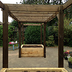 Walk through pergola with new oak raised beds